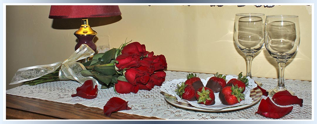 Roses and chocolate dipped strawberries add romance